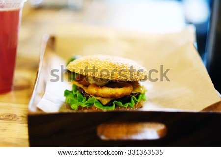 Cheeseburger on sesame buns and drink