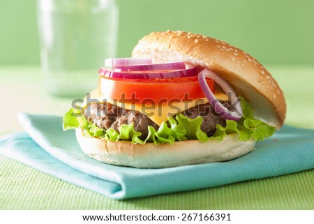 cheeseburger with beef patty cheese lettuce onion tomato - stock photo