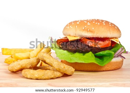 Cheeseburger with lettuce, tomato and onion rings