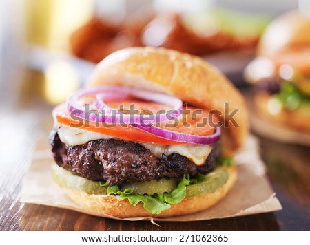 cheeseburgers with wings and beer - stock photo