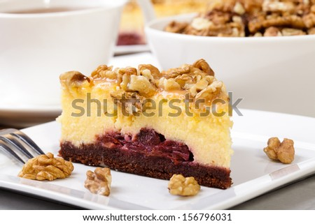 Cheesecak with a cap of coffee or tea (Selective Focus, Focus on the front upper edge of the cake)