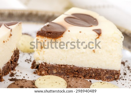 Cheesecake - Chocolate and vanilla cheesecake with chocolate buttons.