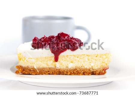 Cheesecake on a plate and coffee cup on a table