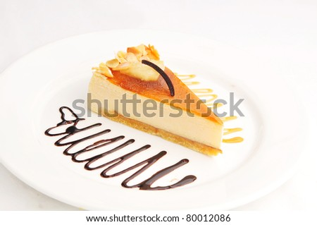 cheesecake on a white plate - stock photo
