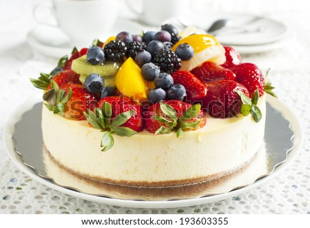 Cheesecake topped with fresh berries and fruits.  - stock photo