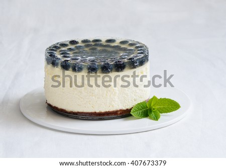 cheesecake with blueberry and lemon jelly - stock photo