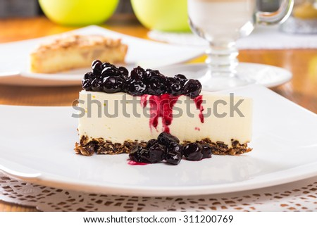 Cheesecake with blueberry jam - stock photo