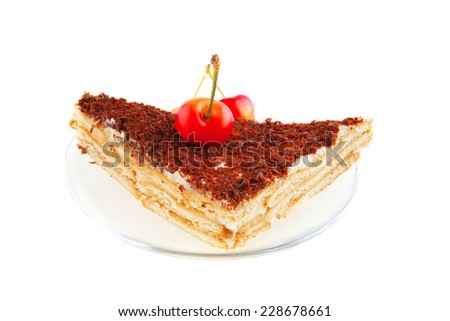 cheesecake with cherry on transparent saucer on white - stock photo