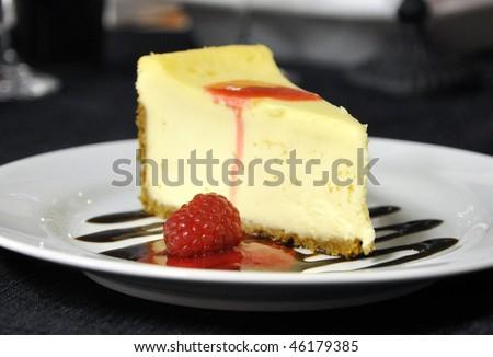Cheesecake with chocolate and raspberry sauce - stock photo
