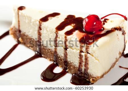 Cheesecake with Chocolate Sauce and Cherries - stock photo