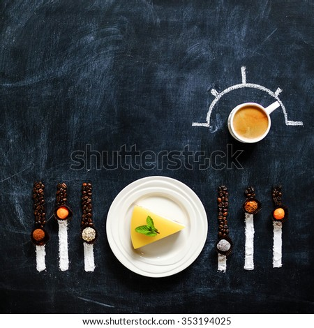 Cheesecake with coffee on a blackboard in a play button and equalizer. View from above - stock photo