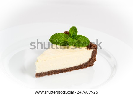 Cheesecake with mint isolated on white background - stock photo