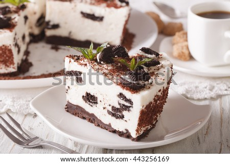 cheesecake with pieces of chocolate cookies close-up and coffee. horizontal