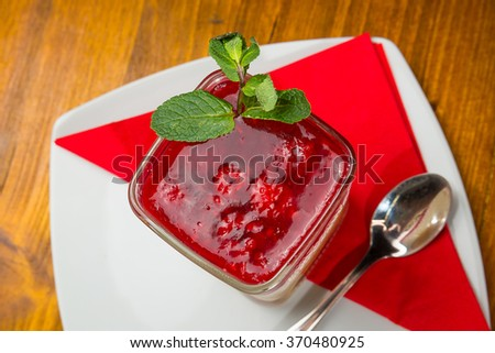 Cheesecake with raspberries served in a glass, ready for consummation. Dessert is served in a glass. - stock photo