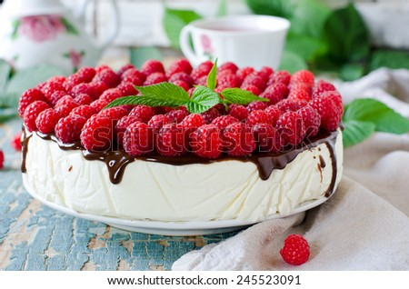 Cheesecake with raspberry and chocolate - stock photo