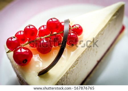 Cheesecake with redcurrant closeup - stock photo