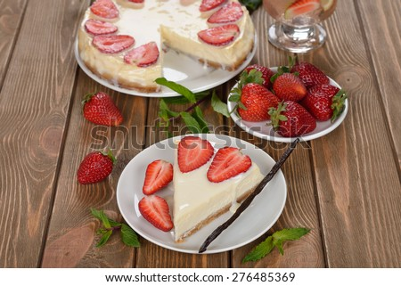 Cheesecake with strawberries on a brown background - stock photo
