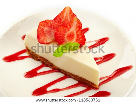 cheesecake with strawberries on white plate - stock photo