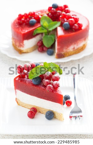 Cheesecake with strawberry jelly on a plate, vertical - stock photo