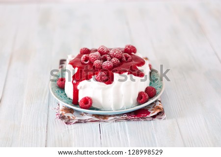 Cheesecake with whipped cream and raspberry - stock photo