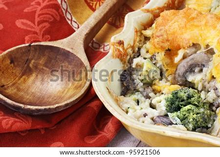 Cheesy broccoli casserole made with cheddar cheese, broccoli, portabella mushrooms and rice. - stock photo