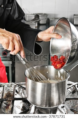 Chef add strawberry in pan with milk