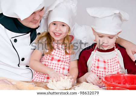 chef and children in the chefs prepare a meal - stock photo