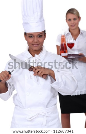 chef and waitress her - stock photo