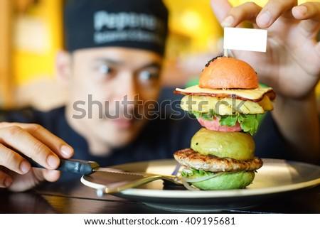 chef arrange  burger  intentionally - stock photo