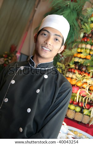 chef at buffet - stock photo