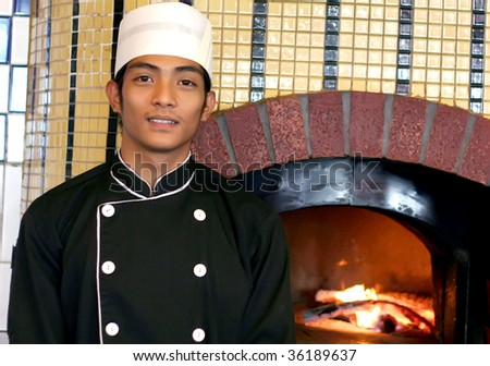 chef at front of pizza oven - stock photo