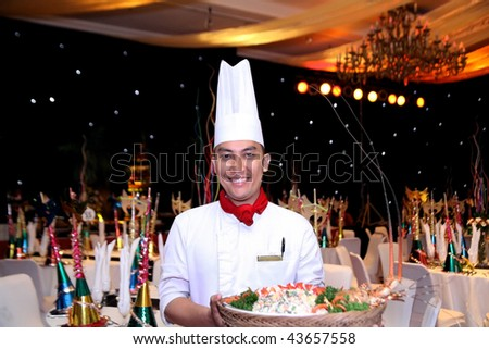 chef at new year gala dinner - stock photo