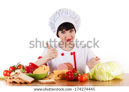 chef at the table full of vegetables