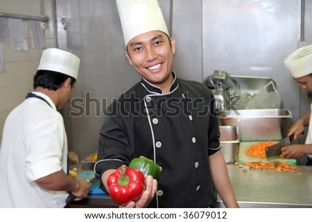 chef at work showing pepper - stock photo