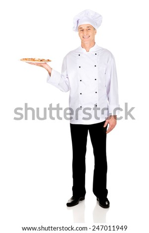 Chef baker with italian pizza on plate. - stock photo