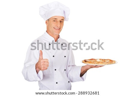 Chef baker with italian pizza on plate showing ok sign.