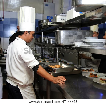 chef busy in the kitchen - stock photo