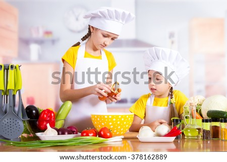 Chef child cooking in the kitchen, playing, laughing, having fun