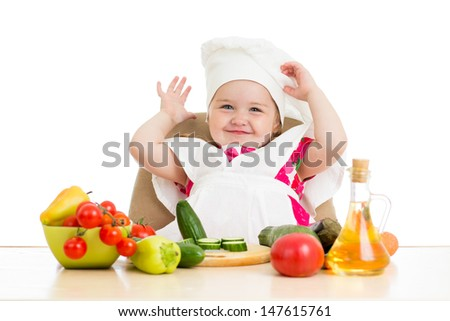 Chef child with healthy food - stock photo