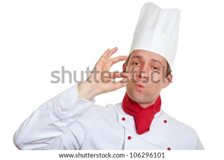 Chef cook making okay gesture with his hands after tasteful meal - stock photo
