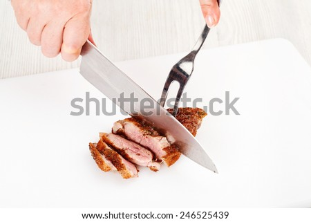 Chef-cook sliced meat on a cutting board. Cutting ingredients closeup - stock photo
