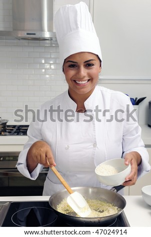 Chef cooking a tasty  risotto  in a modern kitchen - stock photo