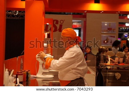 Chef cooking at the fair - stock photo