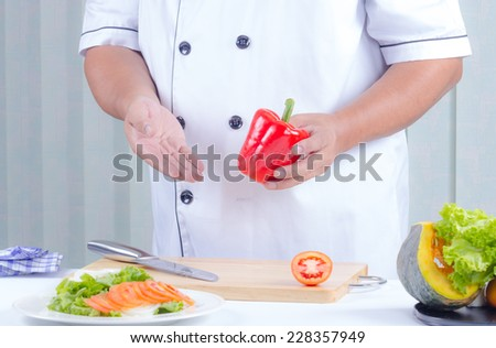 Chef cooking fresh healthy vegetable salad