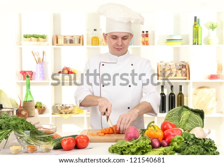 Chef cooking in kitchen - stock photo