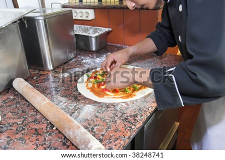 chef cooking pizza - stock photo