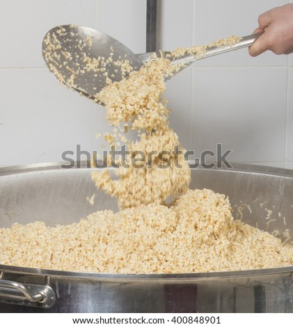 chef cooking rice at a commercial kitchen - stock photo