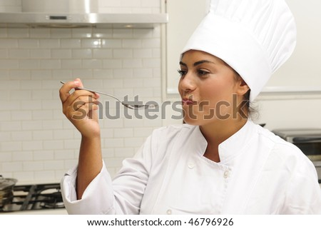Chef cooking risotto having a taste - stock photo