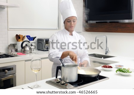 Chef cooking risotto stirring with ladle - stock photo