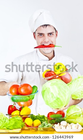 chef cooking vegetables on wooden table at kitchen